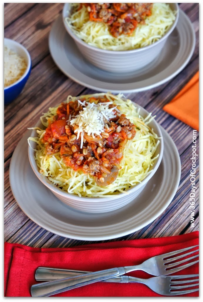 Slow Cooker Spaghetti Squash--An easy way to cook spaghetti squash! Spaghetti squash is a healthy, low calorie alternative to regular pasta and because it has a neutral flavor is soaks up whatever seasonings or sauce you serve with it.