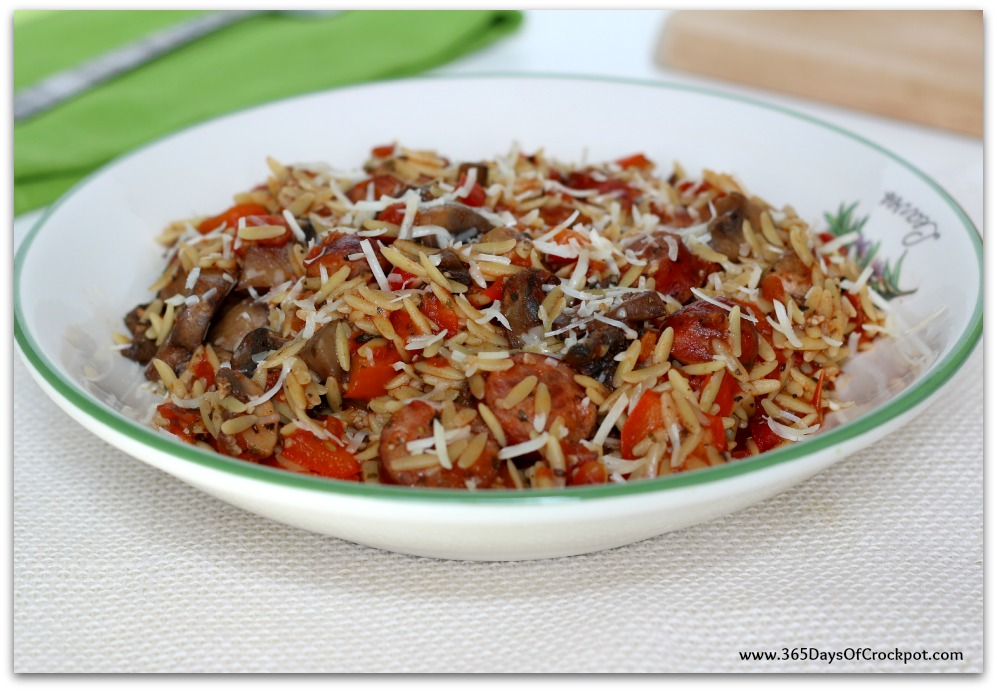 Instant Pot Parmesan Sausage Orzo--smoked sausage, peppers, mushrooms, tomatoes, orzo and parmesan cheese cooked quickly in your pressure cooker. This meal is loaded with flavor and is a dump and go one pot meal.