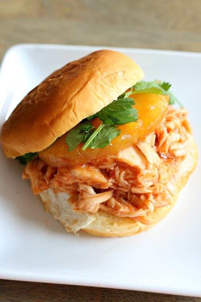 Instant Pot Hawaiian Chicken--a super fast and easy, 4-ingredient, dump and go Instant Pot recipe of slightly sweet chicken and pineapples. Serve this chicken on Hawaiian rolls or over rice.