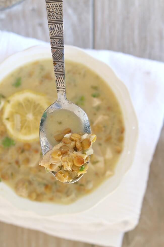 """Slow Cooker Lemon Lentil Chicken Soup: a brightly flavored chicken and lentil soup based on the Greek Classic avgolemono, which translates as """"egg-lemon."""" It is a light and healthy soup that can be served as a starter or as the main dish."""