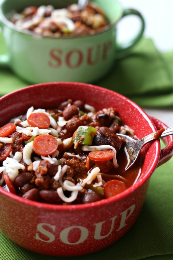Slow Cooker Pepperoni Pizza Chili is the perfect chili for a chilly (get it?) evening or for tailgating. It is packed with mini pepperonis, Italian sausage and green peppers to give you all your favorite pizza flavors. Plus it's of course topped with melty mozzarella cheese.