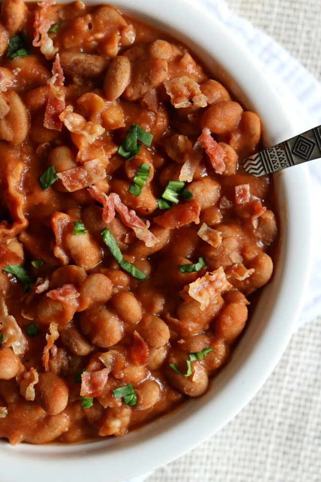 Homemade Slow Cooker Pork and Beans: your childhood favorite pork n' beans made at home in your slow cooker with dried beans and lots of crispy bacon and just a couple other pantry staples.