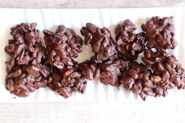Slow Cooker Dark Chocolate Peanut Clusters--homemade chocolate covered peanuts clusters that are made at home in your slow cooker with just 3 simple ingredients.