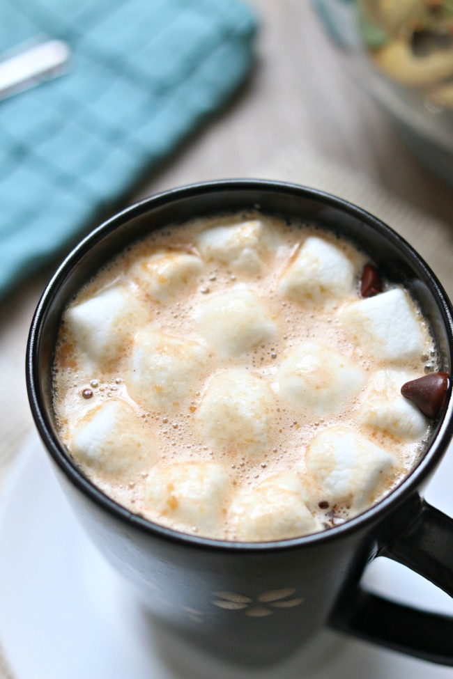 Slow Cooker Peanut Butter Hot Chocolate--chocolate and peanut butter are made for each other and they make a perfect creamy combination in this homemade crockpot peanut butter hot chocolate recipe.