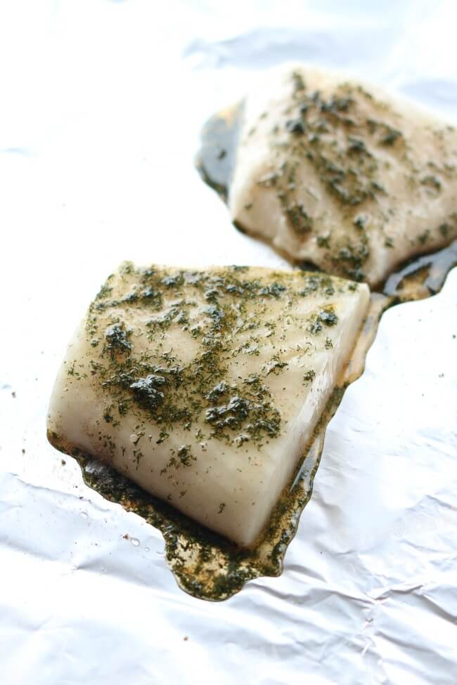 Slow Cooker Lemon Dill Halibut --light and flaky halibut with lemon and dill made in your slow cooker inside a foil packet. No fishy smelling house and super easy clean up makes this a winning way to make fish.
