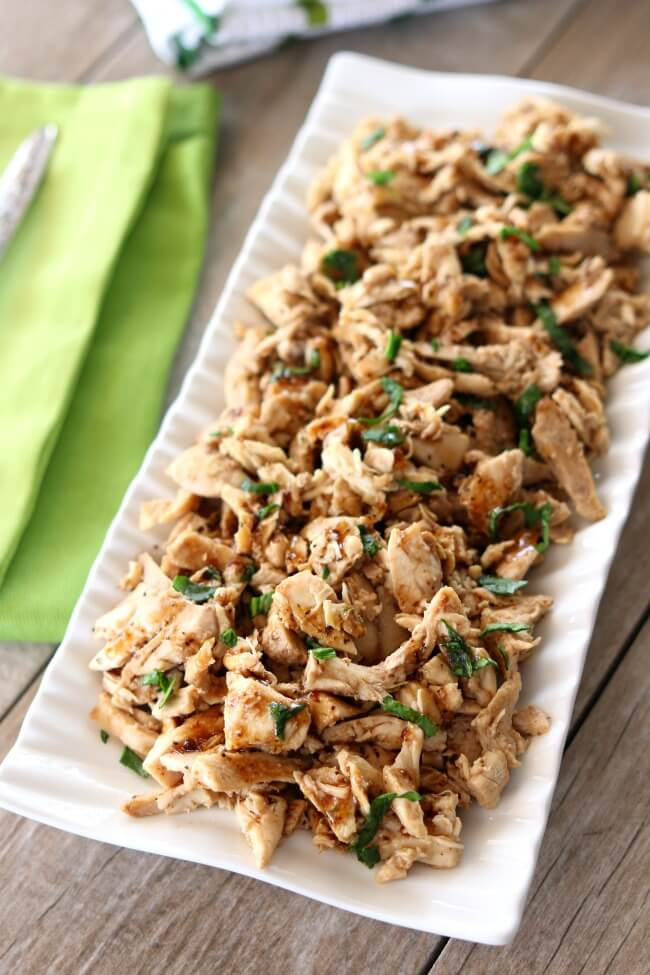 Slow Cooker 2-Ingredient Balsamic Chicken--tender, moist bites of shredded chicken flavored with a light balsamic dressing. With literally only 2 ingredients and the fact that it's made in the crockpot, this recipe couldn't be easier to make. This balsamic chicken tastes great on salads, over rice or with a baked potato.