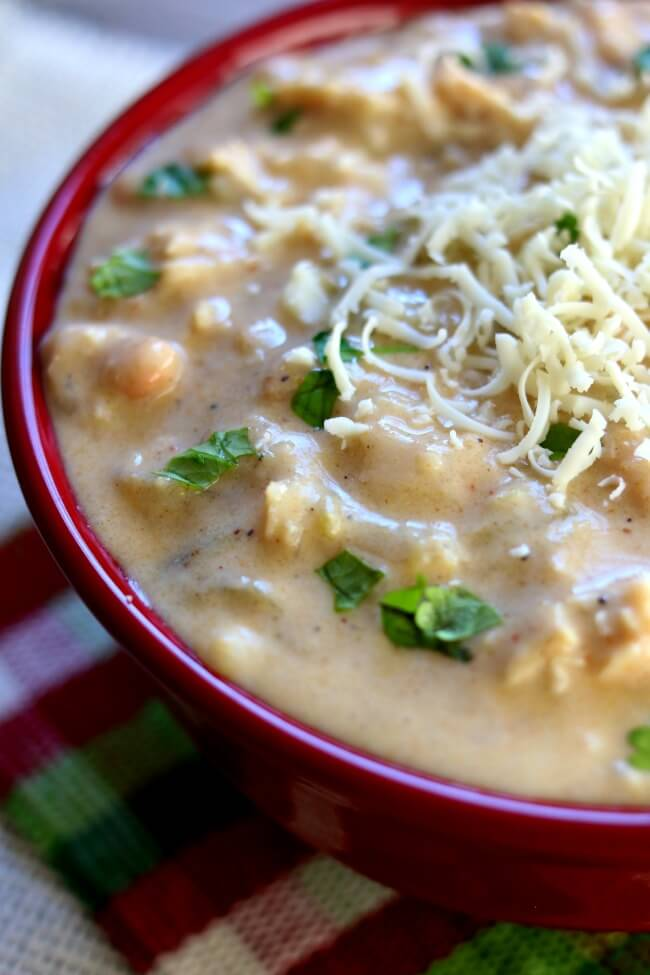Slow Cooker Thick and Creamy White Chicken Chili--an indulgent white chili recipe with green chiles, onion, chicken breasts, and white beans. Win your next chili cook-off with this recipe.