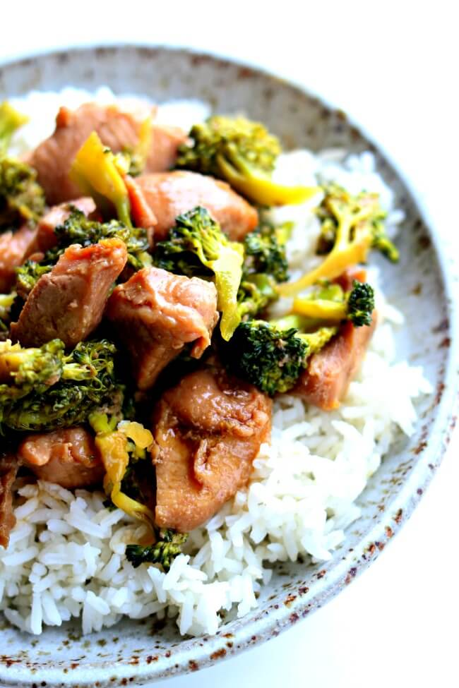 Slow Cooker Pork and Broccoli--you've all heard of beef and broccoli but I'm mixing it up today by using pork sirloin instead. This crockpot recipe is super easy but it will make you feel like you're eating at your favorite Chinese restaurant. Tender pieces of pork and a super savory sauce with semi-cooked broccoli all go together nicely over white rice.