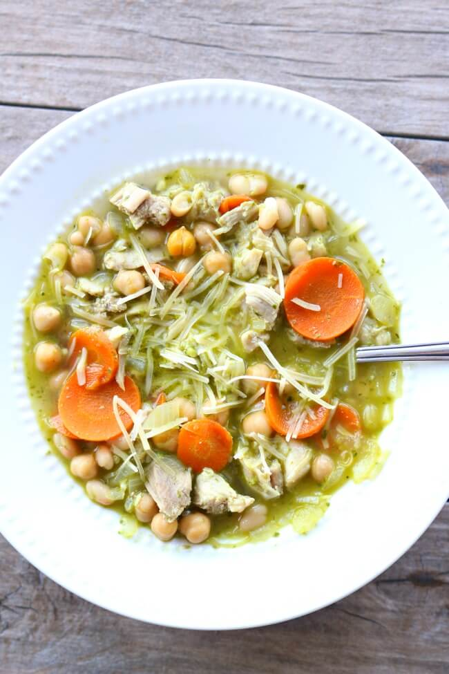 Slow Cooker Chicken Pesto Bean Soup--moist bites of chicken, tender chickpeas and white beans, carrots, celery and onions all cooked in a broth flavored with basil pesto.