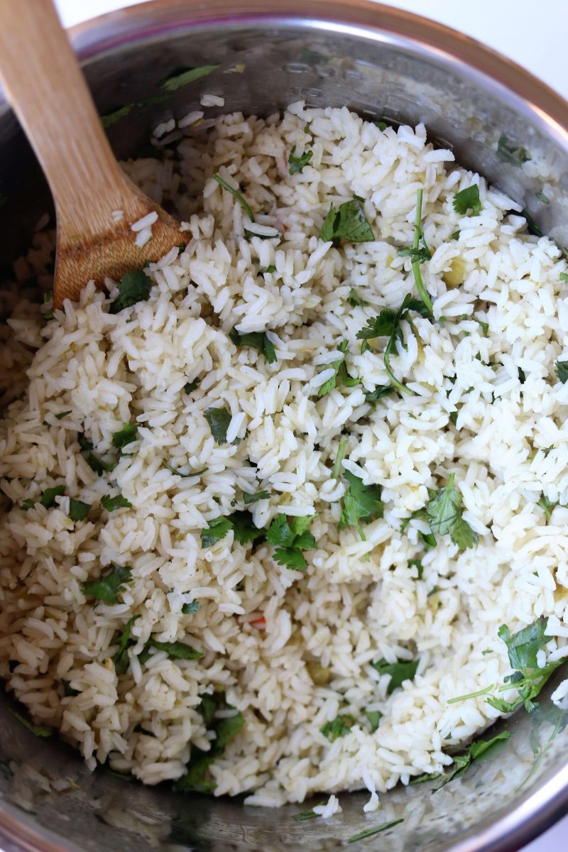 Instant Pot Cafe Rio Cilantro Lime Rice--this quicklycooked seasoned rice made in you pressure cooker is just like Cafe Rio's and it makes the perfect addition to any Mexican dish for dinner.