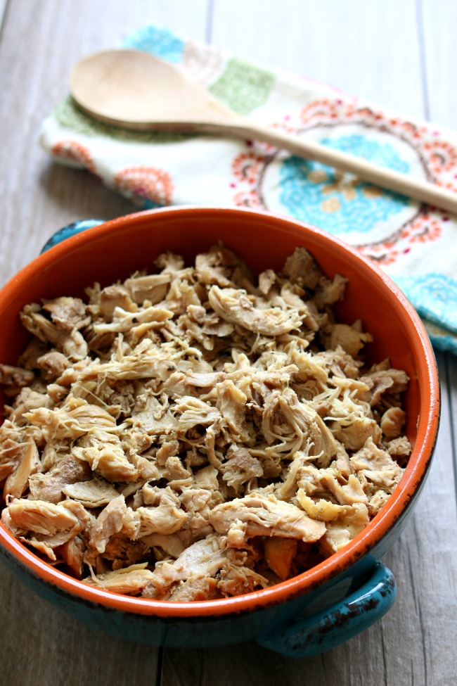 Instant Pot Seasoned Shredded Chicken--if you love rotisserie-style chicken you need to make this chicken! The chicken is made in minutes in your Instant Pot and it's super tender and moist. My husband said to me,