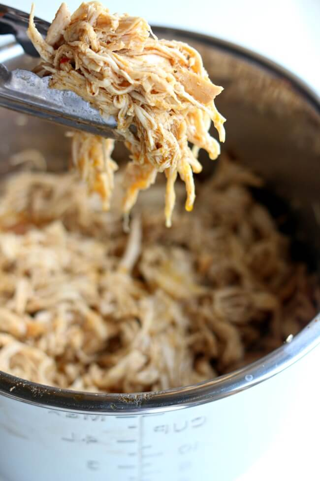 Instant Pot Café Rio Chicken–this quickly cooked shredded chicken is perfect to serve with your Mexican dinners on salads, in burritos, in enchiladas or over rice.