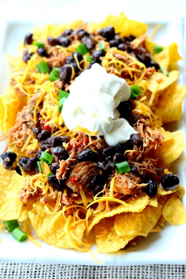 Instant PotMexican Pulled Pork--fall apart tender pork is cooked in your pressure cooker and then a few extra ingredients are added to give the meat a southwestern flare. This pork is perfect for tacos, salads, nachos and burritos!