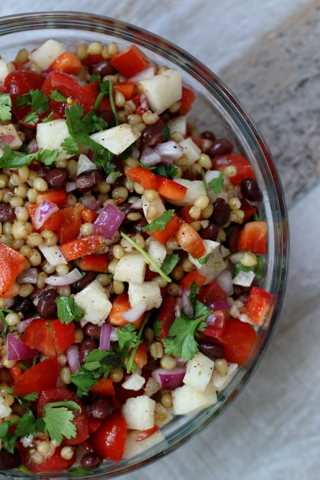 Instant Pot Colorful Wheat Berry Salad--The perfect summer salad for all picnics, potlucks and barbecues. Wheat berries with a lime dressing, black beans, avocados, grape tomatoes, red peppers, jicama, red onion and cilantro. It's got the crunch, the chewiness and the bright flavors all in one salad.
