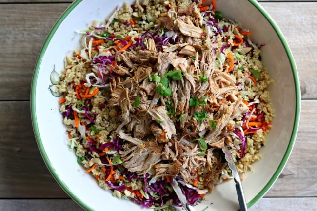 Instant Pot Ginger Soy Pork with Asian Slaw--pork loin is cooked until tender in your electric pressure cooker and then tossed with shredded cabbage, cilantro, green onions, cashews, quinoa and a homemade sesame dressing. This is a perfect summer recipe and it can be made ahead of time.