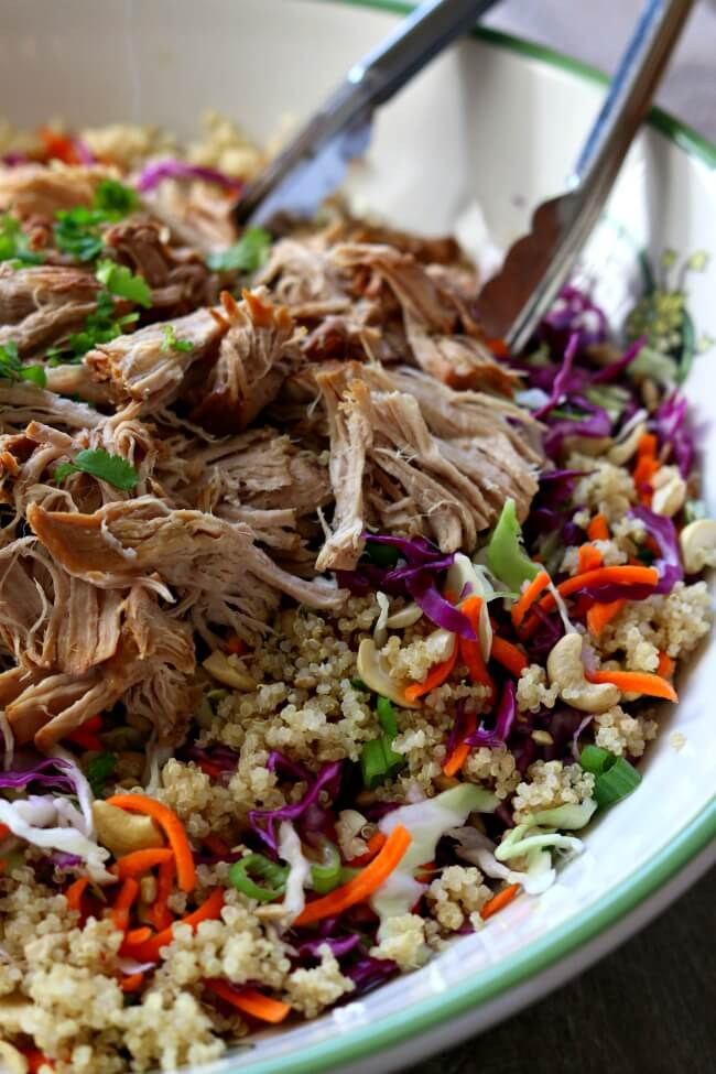 Instant Pot Chopped Chinese Pork Salad--pork loin is cooked until tender in your electric pressure cooker and then tossed with shredded cabbage, cilantro, green onions, cashews, quinoa and a homemade sesame dressing. This is a perfect summer recipe and it can be made ahead of time.