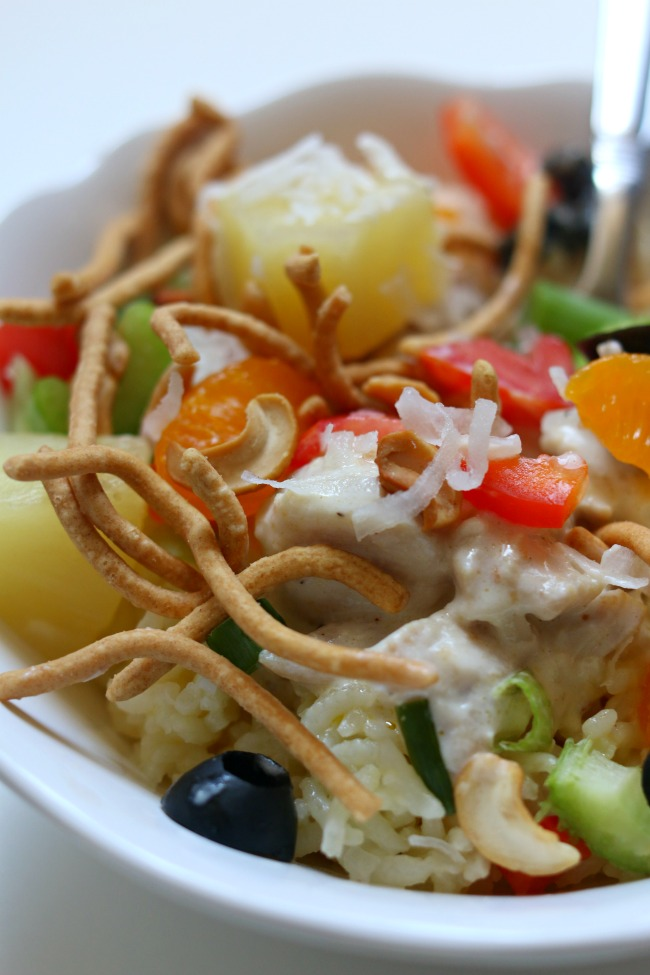 Slow Cooker Hawaiian Haystacks--a kid friendly easy recipe of chicken, gravy and rice and then topped with all sorts of fun garnishes.