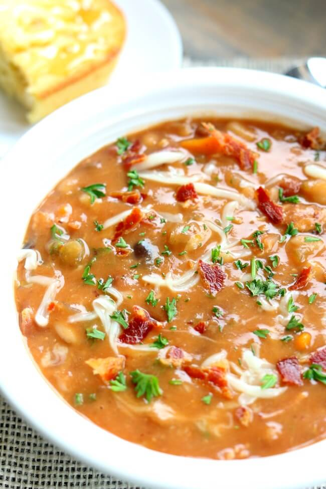 Instant Pot Bean and Bacon Soup--dried beans are cooked quickly in your electric pressure cooker along with carrots, celery, garlic and bacon. A simple but seriously delicious soup that will leave you wanting seconds (and the leftovers the next day are even better than the first day).