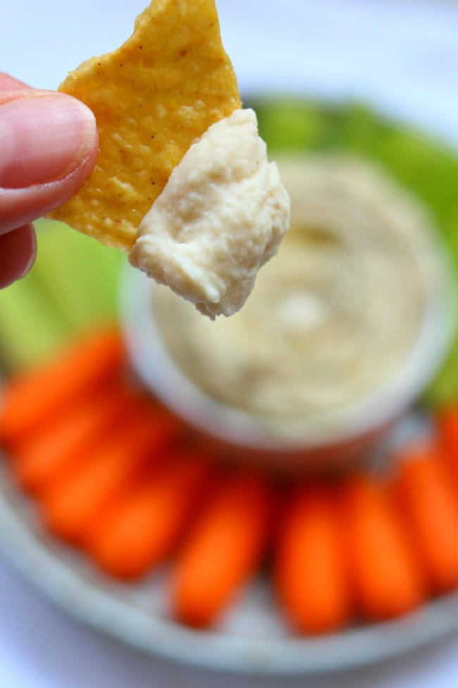 Instant Pot White Bean Garlic Hummus--dried white beans are cooked in just a few minutes in your electric pressure cooker and then pureed with fresh lemon juice, garlic and olive oil to make a simple but delicious dip.