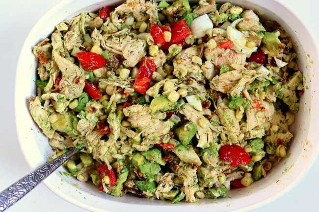 Instant Pot Chicken Bacon Avocado Salad--shredded chicken breasts and hard boiled eggs are cooked at the same time in your Instant Pot and then combined with corn, bacon, green onion, tomatoes and a lemon dill dressing. A fresh and surprisingly filling entree or side dish.