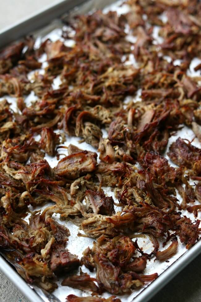 Instant Pot Crispy Pork Carnitas--pork is cooked until tender in your Instant Pot with onion, garlic, jalapeno, and lots of spices. Then the pork is crisped up under the oven broiler to create maximum flavor and texture for tacos, salads, burritos, nachos and enchiladas.