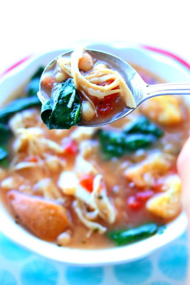 Instant Pot Chicken White Bean Spinach Soup--a healthy and easy recipe for any night of the week. Shredded white meat chicken is enveloped in a flavorful broth and surrounded by seasoned white beans, petite diced tomatoes and fresh spinach.