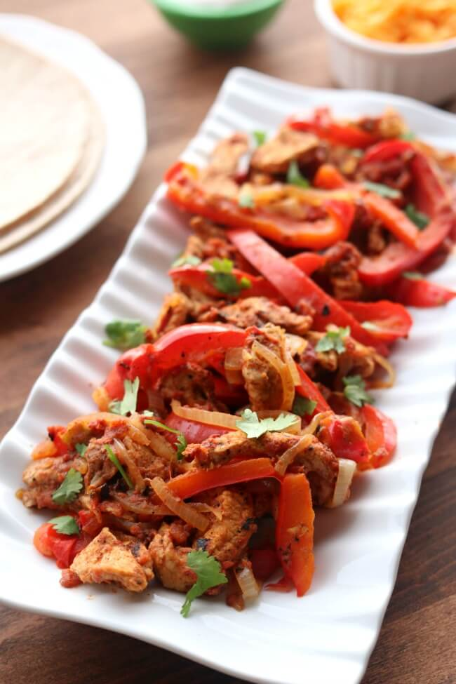 tant Pot/Slow Cooker Pork Chop Fajitas–make amazingly flavorful fajitas (thanks to a secret ingredient) in the Instant Pot or slow cooker with pork chops. When you buy those inexpensive mega packs of pork chops use this recipe to mix up dinner and bring something new to the table (literally).