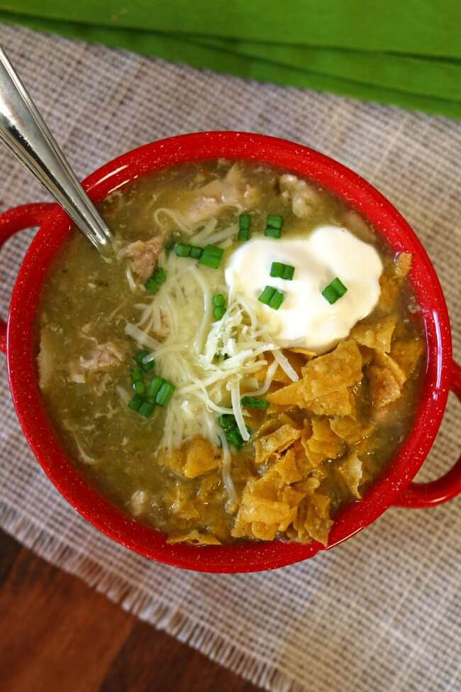 Instant Pot White Chicken Chili--this is a quick to make chili (only 5 minutes of pressure cooking time) that tastes like it's been simmering all day. You can make this recipe with uncooked chicken or cooked chicken or turkey.