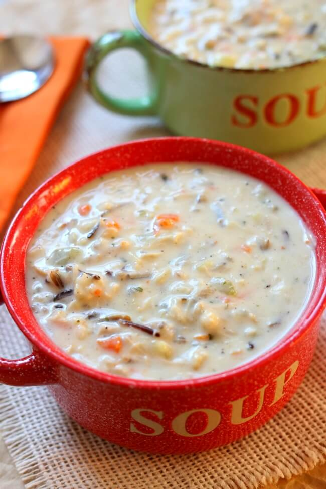 Instant Pot Creamy Wild Rice and Chicken Soup--pure comfort food made quickly in your electric pressure cooker. It's a thick and hearty soup made with wild rice, brown rice, seasonings, vegetables and tender bites of chicken. You can also substitute leftover turkey in this soup. No rice-a-roni packages or pre-packaged foods are used in this version of the soup.