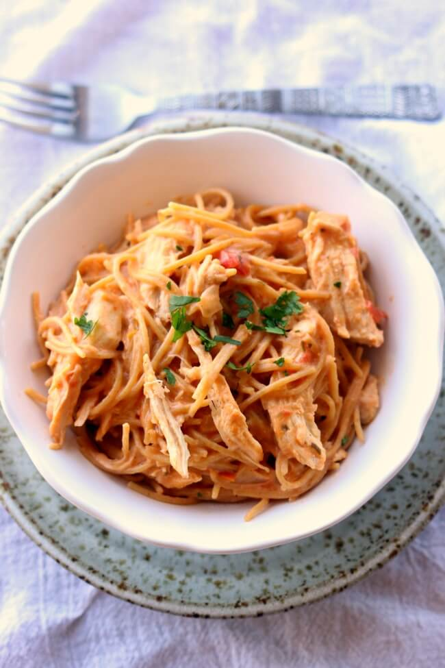 Instant Pot Chicken Spaghetti--creamy spaghetti with shredded chicken blasted with tons of flavor from seasonings and a can of Rotel. An easy weeknight dinner that your whole family will love. Make it quickly in your electric pressure cooker.