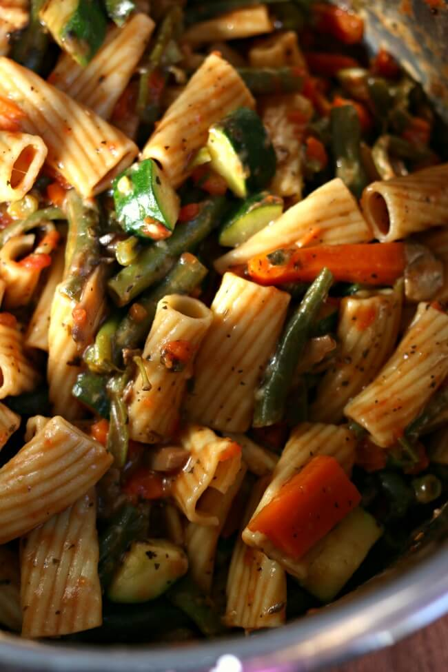 Instant Pot Pasta Primavera--A fresh meatless pasta dish. Rigatoni pasta is cooked quickly in your pressure cooker along with tomatoes, fresh green beans, carrots, mushrooms, garlic and zucchini. The whole dish is tossed with grated parmesan cheese.