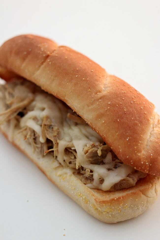 Instant Pot Mississippi Pork Sandwiches--With just a handful of ingredients and 80 minutes in the instant pot you can make fall apart pork that is perfect on sandwiches. This particular recipe has no packets of ranch or au jus. The meat is slightly spicy and infused with flavor.