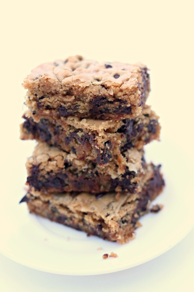 Peanut Butter Chocolate Chip Blondies--peanut butter cookie bars with a plethora of chocolate chips. Eat them while their warm with a scoop of vanilla ice cream or eat them as a snack when their cooled.