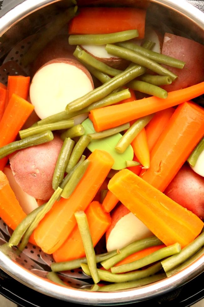 Instant Pot Homestyle Vegetables--a big pot of red potatoes, carrots and green beans steamed in your Instant Pot in a few minutes. These vegetables make a perfect side dish to a chicken or beef dinner.