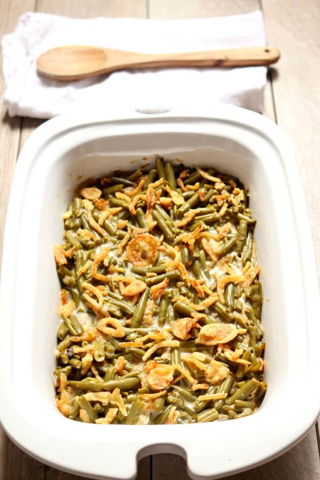 Slow Cooker Green Bean Casserole--a very simple version of your favorite green bean casserole made in the slow cooker. Making this casserole in your slow cooker can free up valuable oven space and also makes this dish very portable.