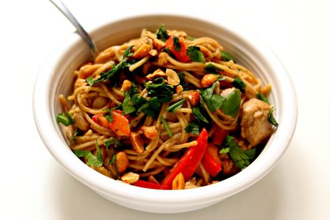 Instant Pot Thai Chicken Noodles--a true one pot meal! The chicken, sauce and noodles are all cooked at the same time in minutes in your electric pressure cooker. The noodles are enveloped in a mild creamy peanut and lime sauce and the peanuts, cilantro and red bell peppers give texture and color. A delicious and easy recipe to make any night of the week.