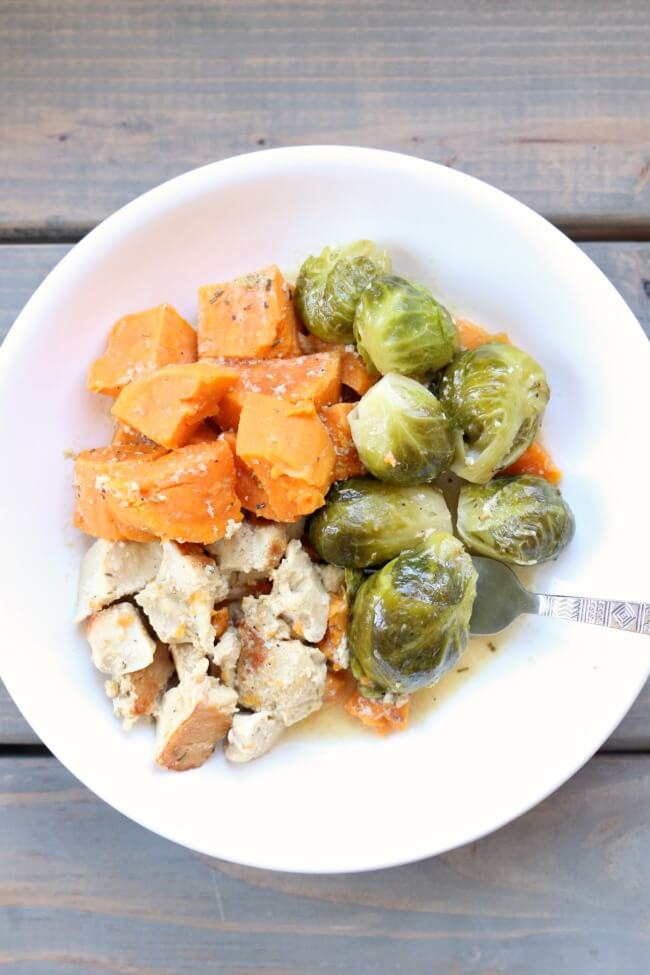 Instant Pot Maple Dijon Chicken and Sweet Potatoes--chicken, sweet potatoes and brussels sprouts drizzled with a sauce made with maple syrup, dijon mustard, rosemary and olive oil. A simple one pot recipe with a delicious flavor!