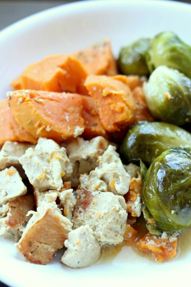Slow Cooker OR Instant Pot Maple Dijon Chicken and Sweet Potatoes–chicken, sweet potatoes and brussels sprouts drizzled with a sauce made with maple syrup, dijon mustard, rosemary and olive oil. A simple one pot recipe with a delicious flavor!