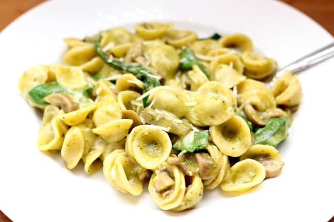 Instant Pot Spinach Mushroom Pesto Pasta--an easy, tasty and fast meatless meal of your favorite type of pasta enveloped in a basil pesto sauce with plenty of sauteed mushroomsand spinach. Add bites of chicken if you prefer.