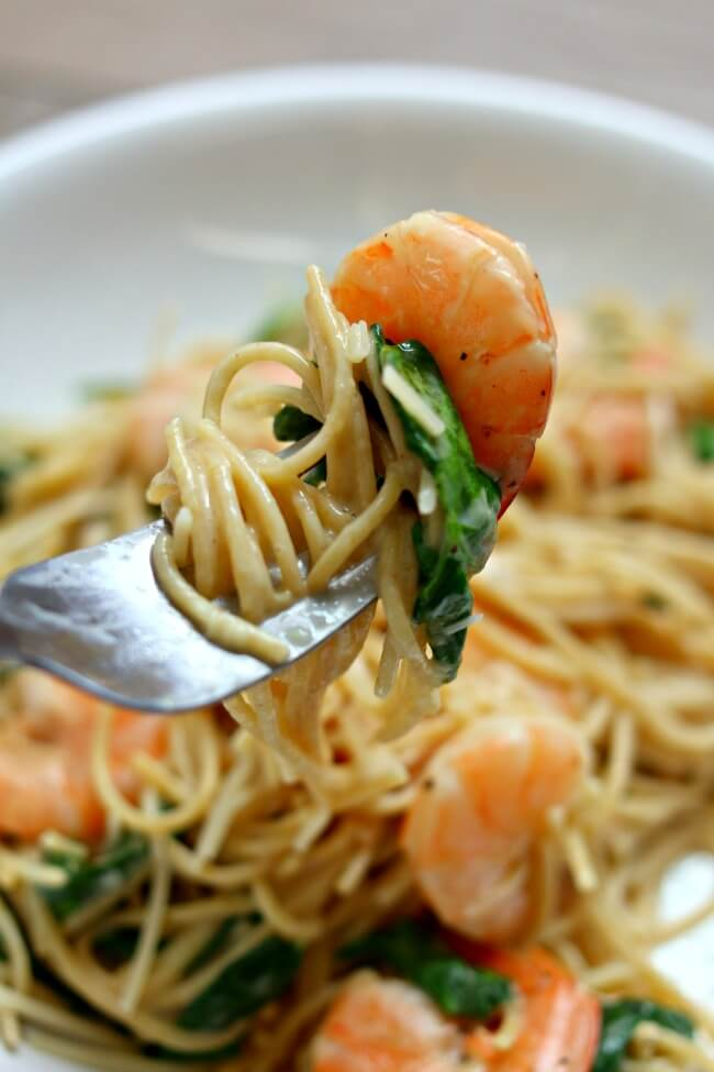 Instant Pot Lemon Garlic Parmesan Shrimp Pasta--a creamy sauce made with garlic, lemon and parmesan cheese encomapsses thin spaghetti and shrimp. This recipe is cooked in just a few minutes thanks to your electric pressure cooker.