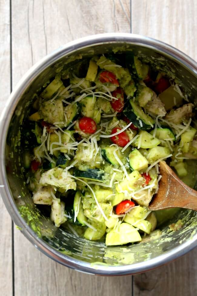Slow Cooker Chicken Pesto and Vegetables--tender bites of chicken, zucchini, cherry tomatoes and potatoes enveloped in flavorful basil pesto sauce. An easy one pot meal that you can make in your crockpot.