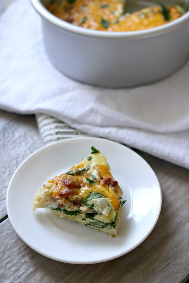 Instant Pot Bacon Cheddar Egg Casserole--hashbrowns, eggs, bacon, cheddar and spinach are all combined to make a scrumptious breakfast casserole that is perfect for a weekend breakfast or even breakfast for dinner.