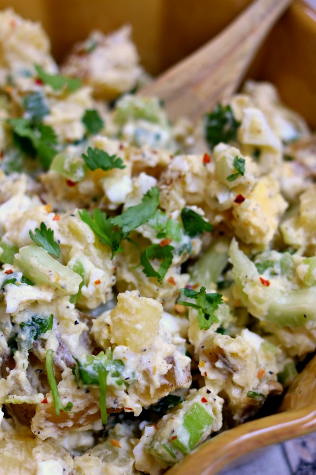 Instant Pot Cilantro Lime Potato Salad--cilantro and a hint of lime create a memorable take on classic potato salad. By cooking the eggs and potatoes togetherin your Instant Pot you'll cut down on steps, dishes and time! Try this recipe out and you may never go back to regular potato salad again.