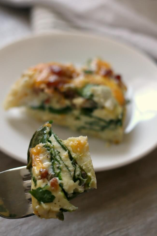 Slow Cooker Bacon Cheddar Egg Casserole--hashbrowns, eggs, bacon, cheddar and spinach are all combined to make a scrumptious breakfast casserole that is perfect for a weekend breakfast or even breakfast for dinner.
