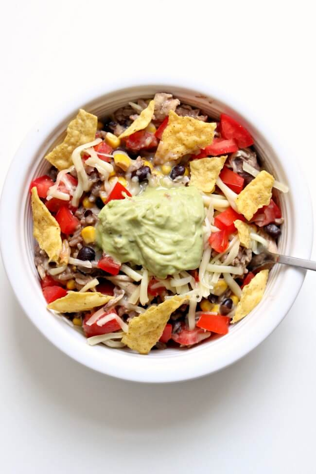 Instant Pot Mexican Chicken Rice Bowl--white meat chicken with dried black beans, corn, and tomatoes over brown rice and topped with monterey jack cheese. An easy weeknight meal that allows you to make dried black beans at the same time as brown rice and in the same pot.