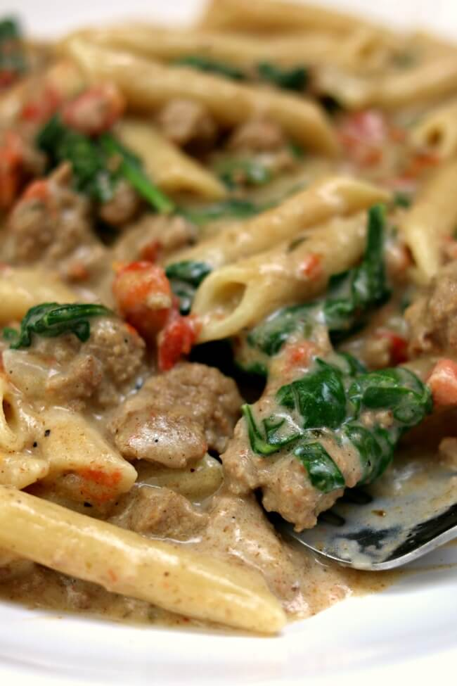 Instant Pot Creamy Turkey Spinach Penne--saucy penne pasta with ground turkey, tomatoes, green chiles, cumin, cream cheese and spinach. Make it fast in the electric pressure cooker.