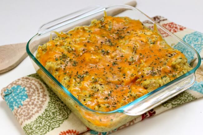 Slow Cooker Chicken Curry Broccoli Casserole--creamy mild curry-flavored rice with chunks of tender chicken, florets of broccoli and lots of cheddar. A family favorite casserole recipe perfect for any weeknight.