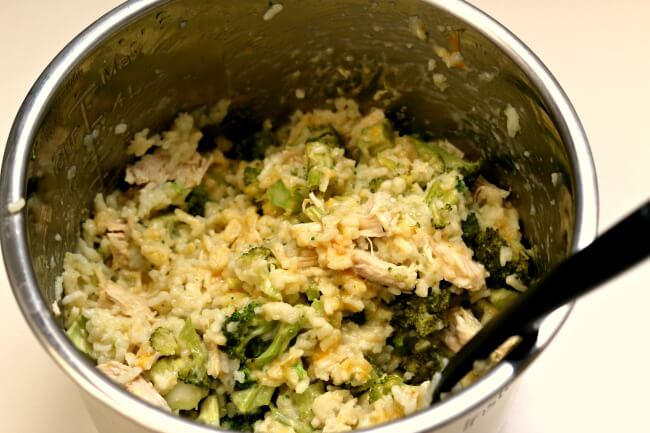 Instant Pot Cheesy Broccoli Rice--creamy risotto-like rice with cheddar, broccoli and (optional) pieces of chicken breast. A one pot family-friendly meal perfect for a busy weeknight.