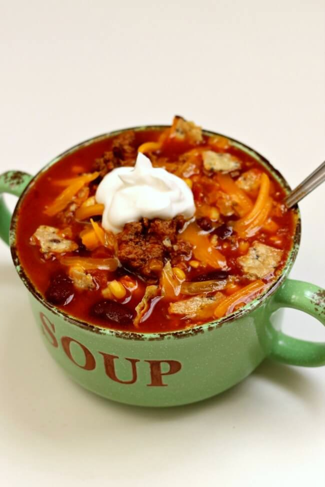 Instant Pot Taco Soup--basic but delicious taco soup that can be made quickly in your electric pressure cooker. Everyone needs this recipe up their sleeve for those busy weeknights.