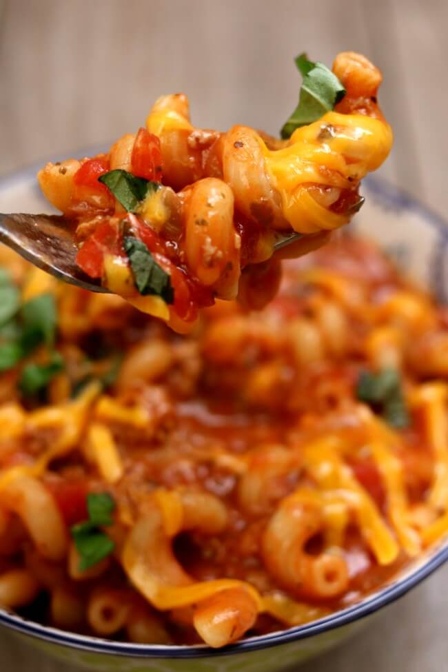 Instant Pot Old-Fashioned Goulash is an old family favorite recipe. Ground beef or turkey is browned and then simmered with a tomato-based sauce and macaroni noodles and then topped with grated cheddar. The perfect weeknight dinner to feed a family. Make it quickly in your electric pressure cooker.